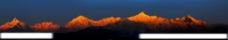 日出映辉下的群山俊峦图片